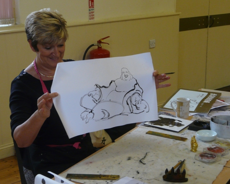 2014-09-20 Claire teaching Happy Buddhas